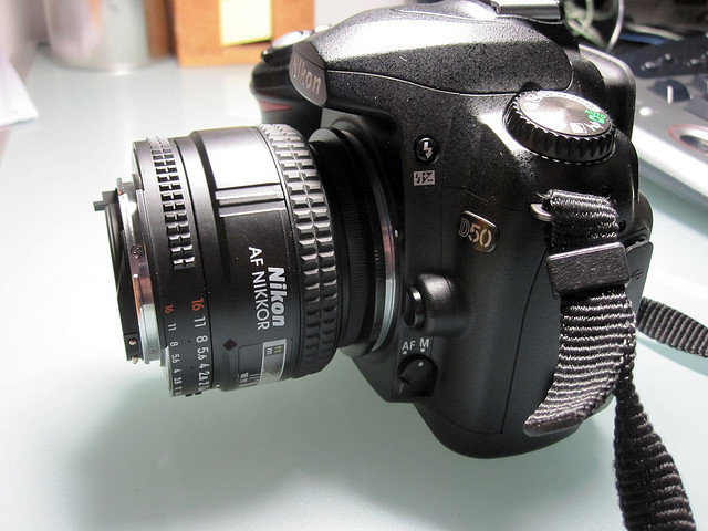 Lens reverse mounted on camera for macro photography