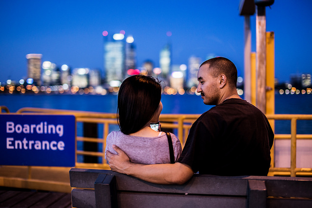 Couple on a bench at twilight, taken at f/1.8