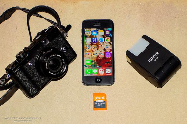 Example of a Nimble Photographer's kit - A Fujifilm X10 camera, Fujifilm EF-20 flash, iPhone 5, and an Eye-Fi memory card