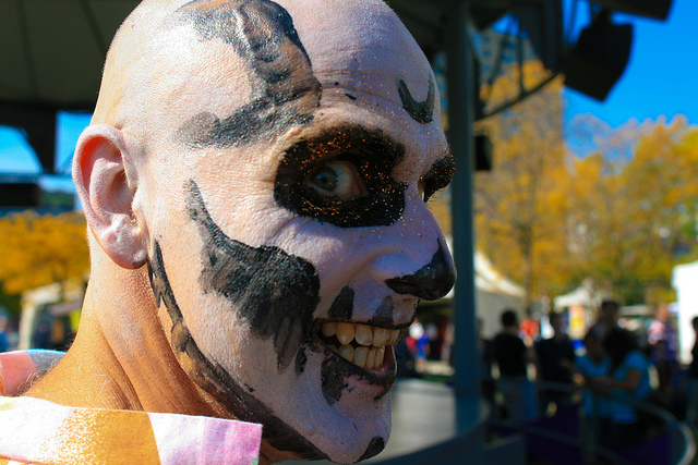 Portrait of a man in face paint taken with a 24mm f/1.4 prime lens with the background out of focus but still discernible
