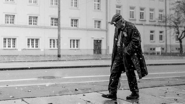 Street photography - man walking in the snow