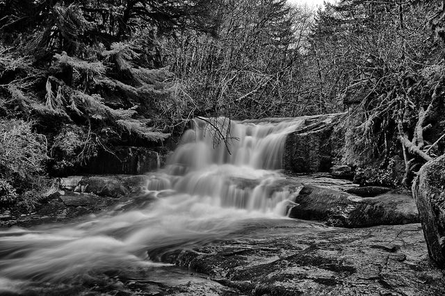 Long exposure of a waterfall taken on an overcast and foggy day