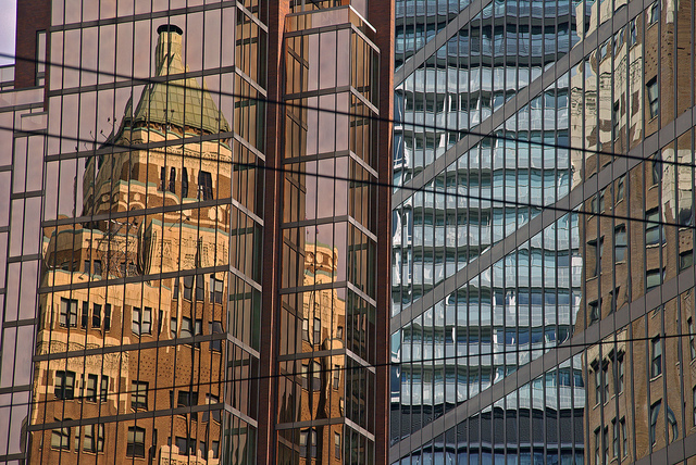 Warped reflections of buildings in glass covered office blocks