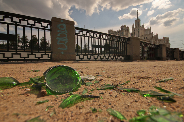 Example of perspective with an ultra wide angle lens - fragments of bottle in the foreground take up as much space in the image as a wall in the middle ground, which takes up as much space as large buildings in the distance