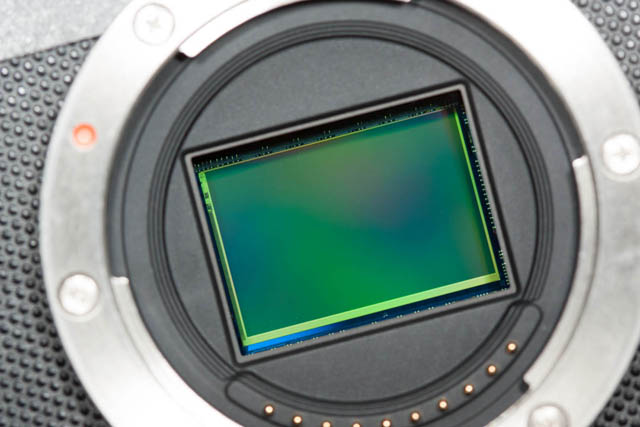 Exposed image sensor in a mirrorless interchangeable lens camera