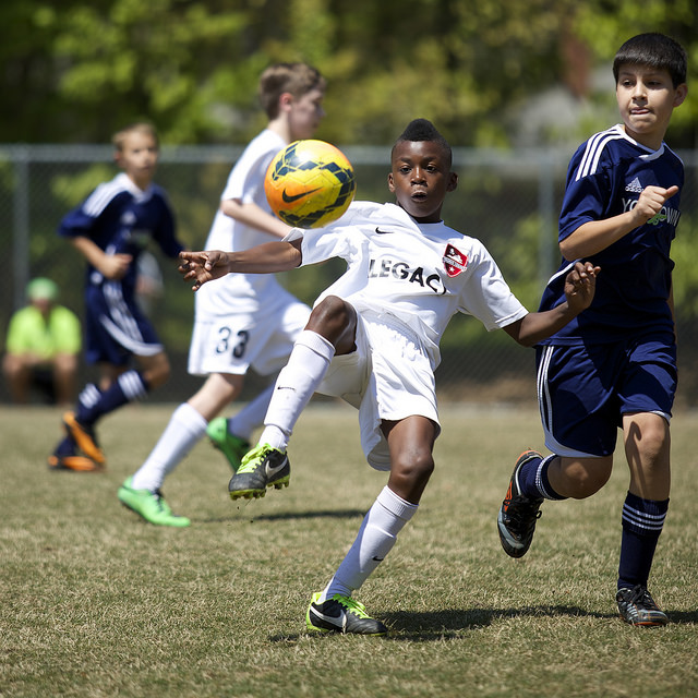 Boys playing Soccer, captured using continuous autofocus with back button for focusing