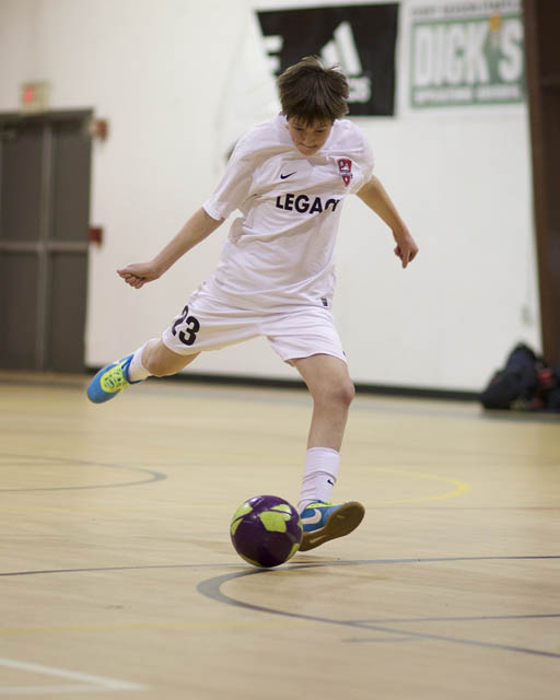 Indoor soccer shot in low light using a fast lens and high ISO to geta a fast enough shutter speed to freeze the action