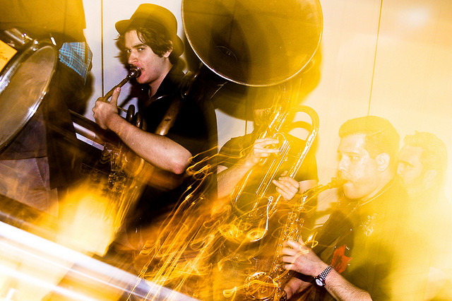 Slow sync flash photo of brass band playing