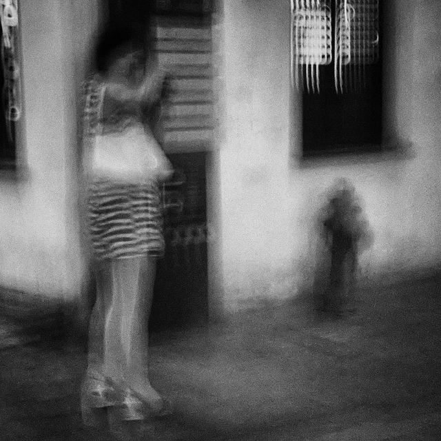 Impressions - blurry photo of a woman on a street in China