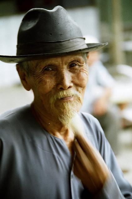 A portrait of an old vietnamese man. Despite being slightly blurry, it is still a good photo.