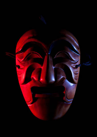 Mask lit by flashes gelled with colored wrappers from chocolates