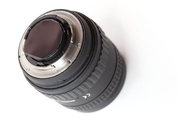 Gel filter attached to rear of lens using double sided sticky tape