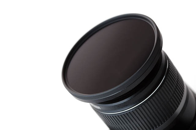 Screw thread ND filter attached to lens via a stepping ring