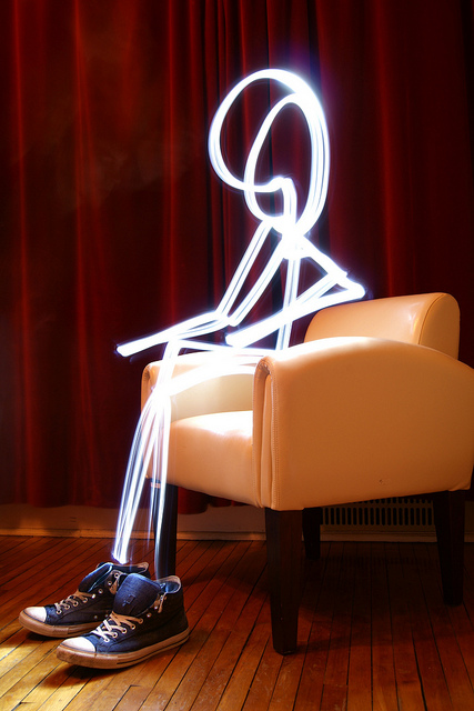 Light painting of a stickman sitting in a chair