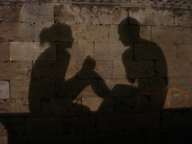 shadows of a couple on a wall