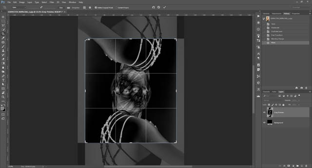 Using the crop tool to crop the image to where the two layers overlap one another