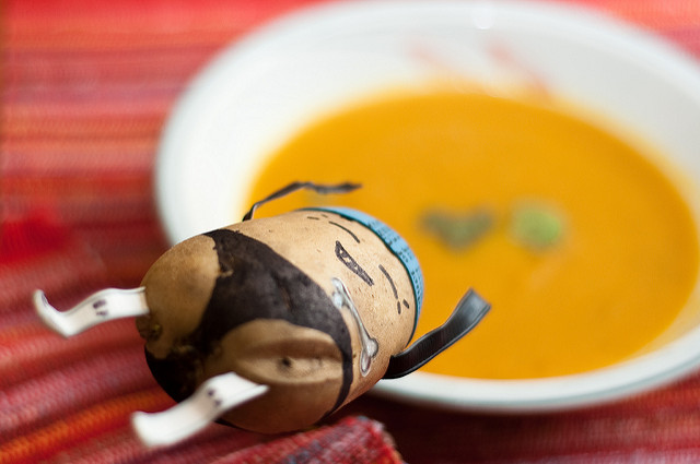 Carrot curry soup, so yummy that Mr. Uncooked Potato dives right into it