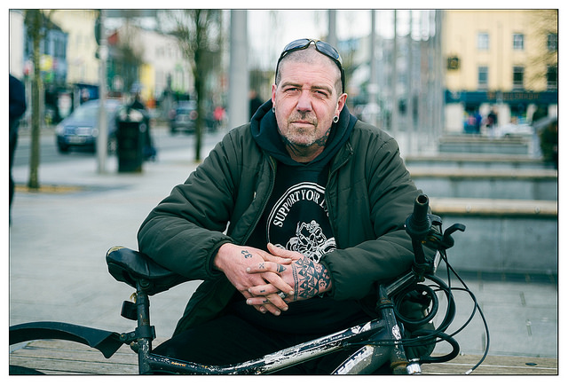 Photo of a man and his bike from a 100 strangers photography challenge project