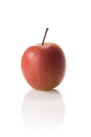 Photo of an apple lit with off-camera flash, the image appears much more '3D'