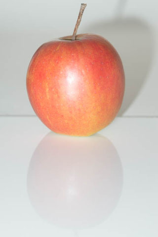 Photo of an apple lit with the camera's pop-up flash - lighting is very boring and flat