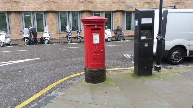 Red British post box, only taking up a small portion of the frame
