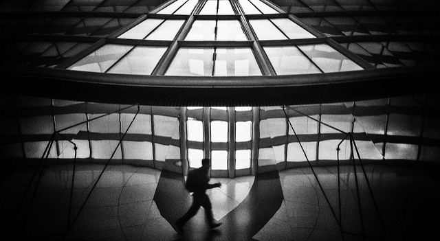 Rushing man at Chicago O'Hare Airport, with a strong tonal contrast between the dark silhouette of the man and the bright windows