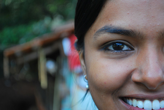 A very close-up portrait where part of the face fills the right of the frame. Due to the closeness of the camera to the subject, the background is rendered out of focus. Taken using a kit lens at 55mm f/1.8.