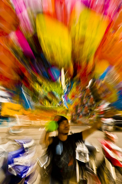 Colorful zoom blur photo of a balloon seller