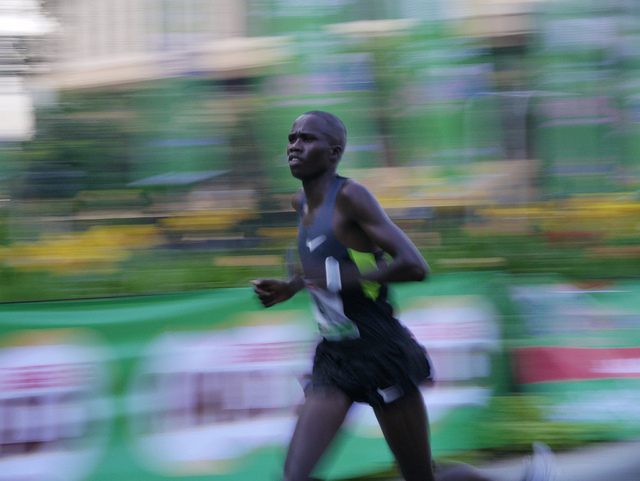 Panned photo of a runner with motion blur giving a sense of speed