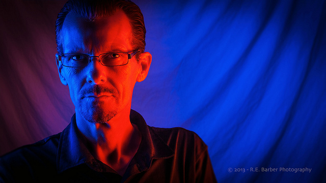 Portrait lit with red and blue gelled flashes