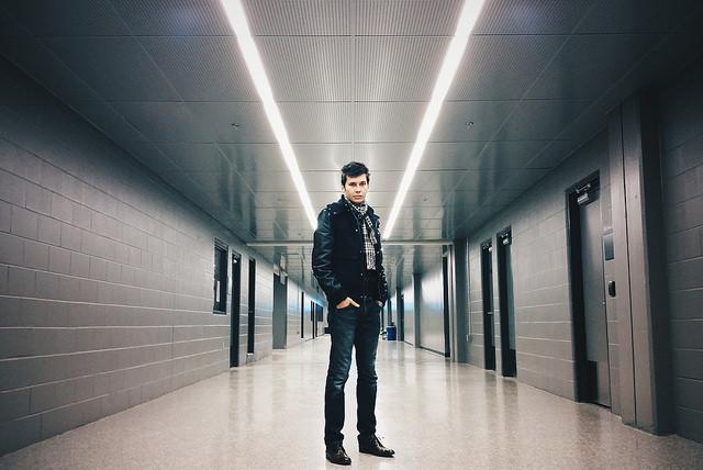Portrait taken in corridor forming strong converging lines