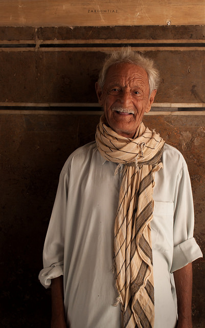 Portrait of Baba Shami taken under soft directional lighting. The lighting brings out highlights and shadows across the subject, giving depth to the image.