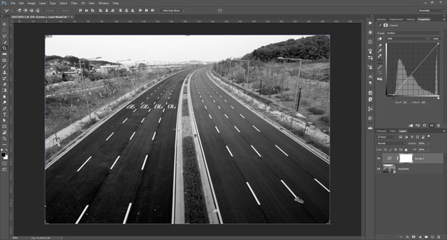 Image with increased contrast by pulling in black and white points on the curve