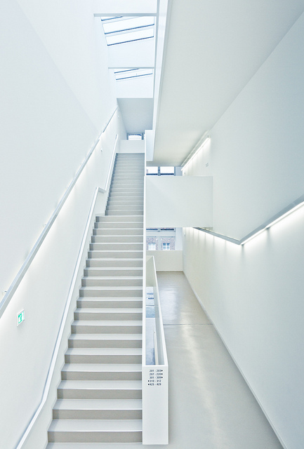 Low contrast high key (bright) indoor architectural photo of some stairs and a corridor
