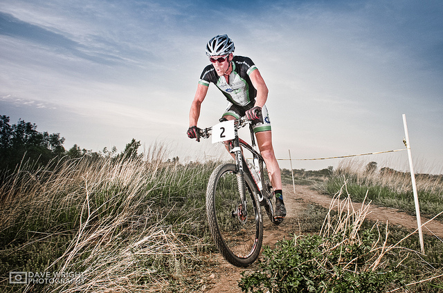 Photo of rider in a mountain bike race / time trial, lit by two speedlight flashes.