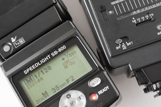 A relatively modern speedlight (on the left) compared to an old model (on the right). The newer speedlight offers manual power from 1/128 power in 1/3 stop steps, while the old flash only allows whole stop adjustments down to 1/16 power.