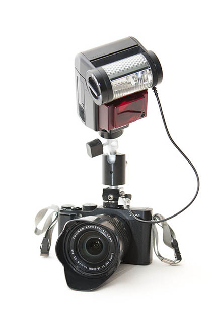Using a mini-ballhead to tilt down a flash on-camera