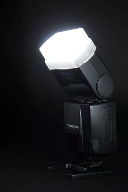 Speedlight flash on stand, with diffusion dome attached