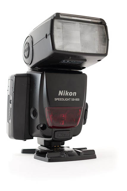 Speedlight with extra battery pack attached